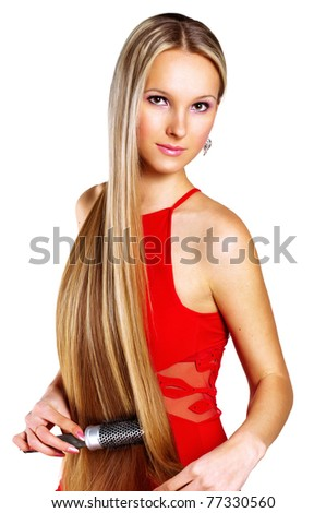 Young woman comping her hair. Isolated over white background.