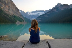 Young woman contemplating at Lake Louise, Canada