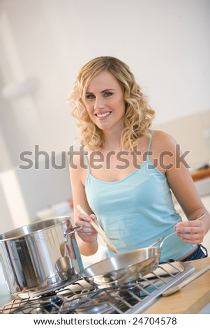 young woman cooking in a kitchen