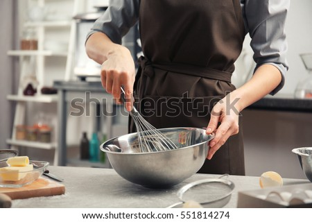 Young woman cooking in kitchen #551814274