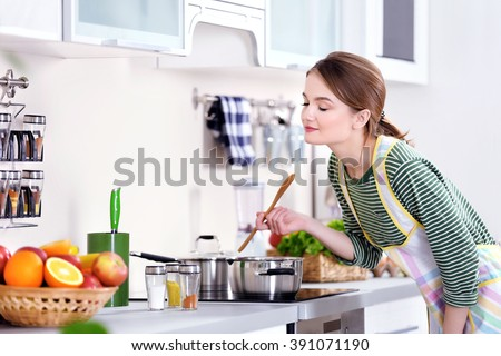 Royalty free young woman cooking in the kitchen 393654247 for Naked in kitchen pics
