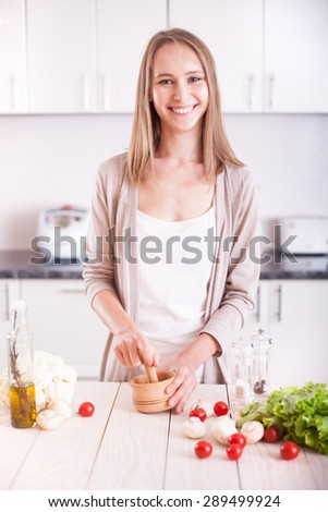 Young Woman Cooking in the kitchen. Dieting vegetarian concept. Healthy Lifestyle. Cooking At Home. Prepare Food