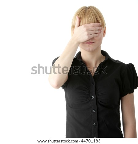 Young woman covering her eyes isolated on white