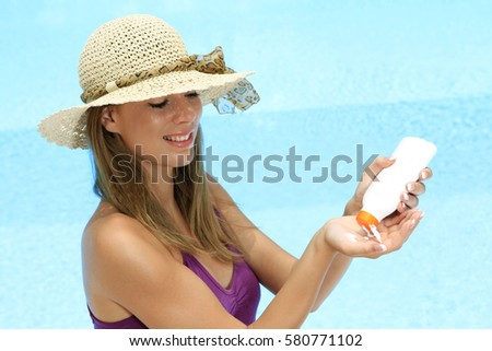 Young woman creaming with a sun protection #580771102