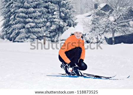 young woman cross-country skiing in a forest