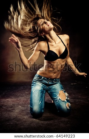 young woman dance on the floor, studio shot