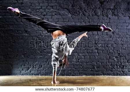 Young woman dancer on wall background. Contrast colors.