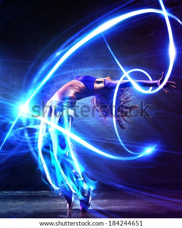 Young woman dancer. With light effects. #184244651