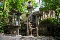 Young woman dancing in surrealistic garden of Edward James. Xilitla, San Luis Potosi, Mexico.