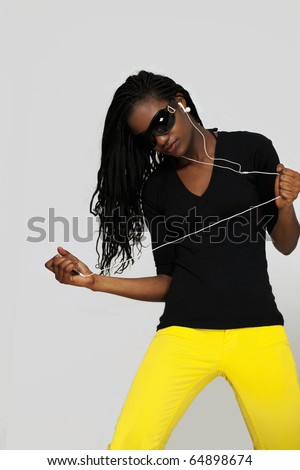 Young woman dancing to music with earphones