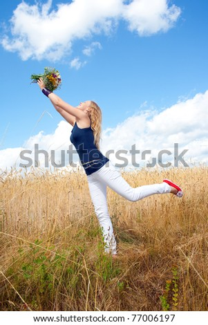 Young woman dancing with bouquet