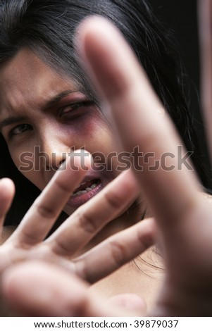 Young woman defending herself, can be used for domestic violence concept