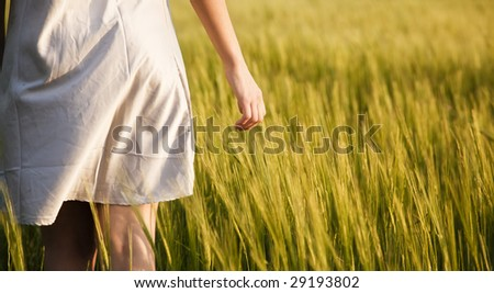 Young woman detail on field