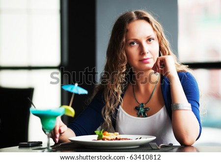Young woman dining at a restaurant.
