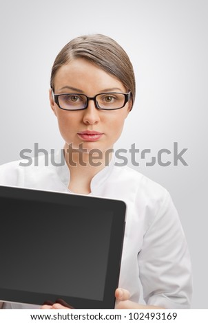 Young woman doctor in white coat  holding digital tablet pc