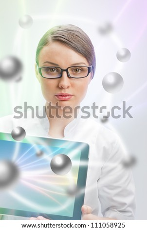 Young woman doctor in white coat  holding digital tablet pc with technology collage