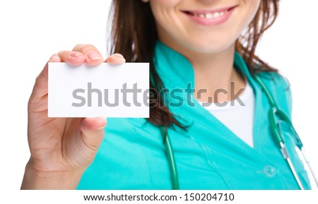 Young woman doctor is showing her business card, isolated over white - stock photo