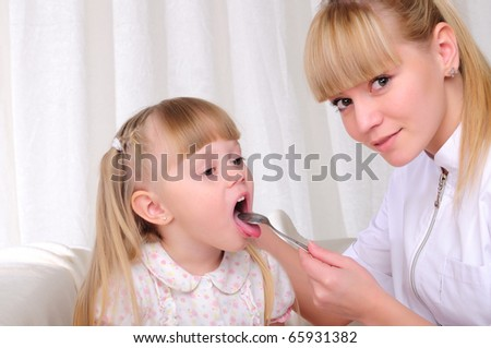 Young woman doctor looks at her little throat patients