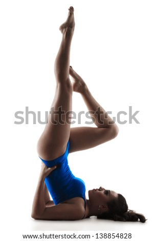 Young  woman does fitness exercise birch, isolated on a white background - stock photo