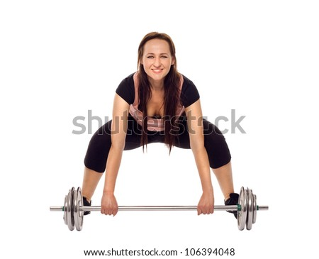 Young woman doing a fitness workout with weights