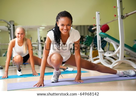 Young woman doing exercises at the fitness club