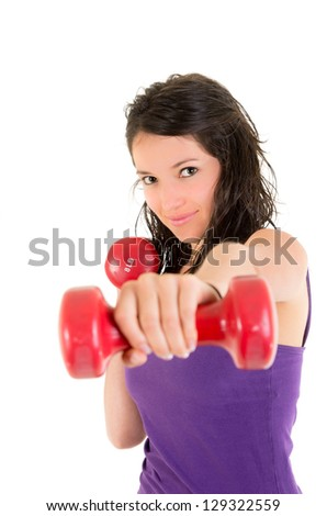 Young Woman doing fitness exercise with hand weights.