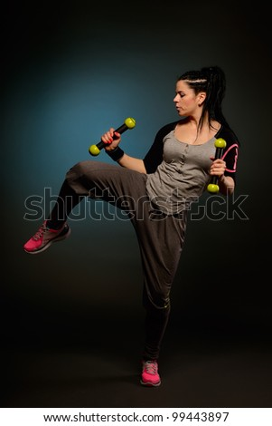 young woman doing fitness exercises - stock photo
