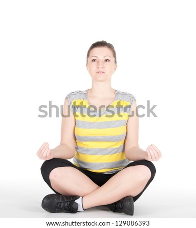 Young woman doing fitness exercises isolated on white background.