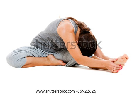 young woman doing flexibility exercise. isolated on white background