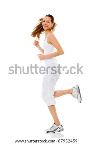 Young woman doing gymnastics on white background studio