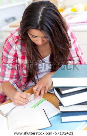 Young woman doing her homework at a table