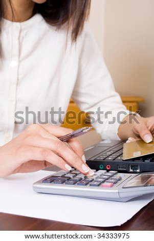 young woman doing home financial calculations