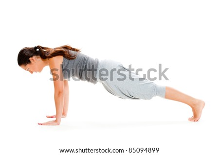 young woman doing push-up exercise on floor. isolated on white background