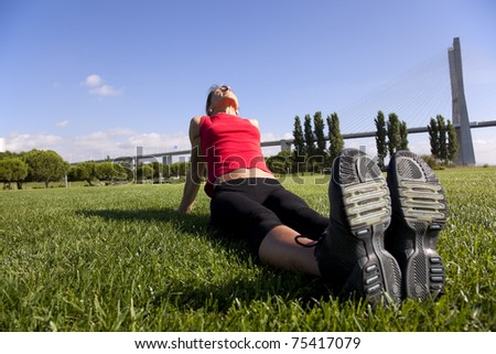 young woman doing some exercise at the park