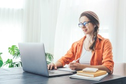 Young woman doing some on-line classes staying at home. Self isolation concept.