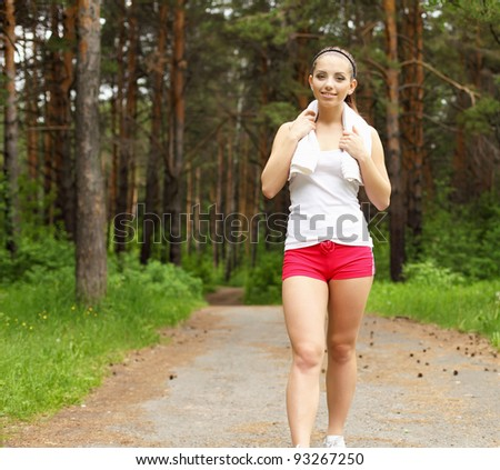 Young woman doing sport outdoors in summer