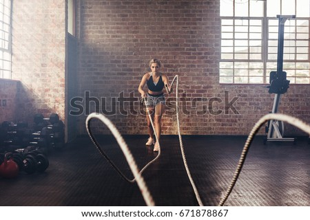 young woman doing strength...