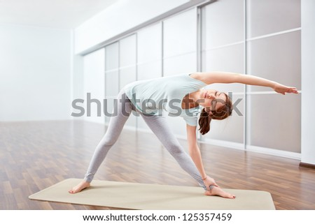 Young woman doing stretching