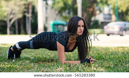 Young woman doing stretching before running outdoors in a park, close up portrait. Miami, Florida.