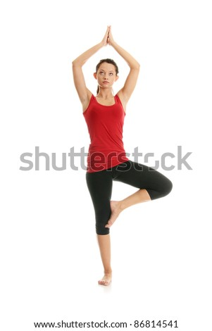 Young woman doing yoga exercise, isolated on white