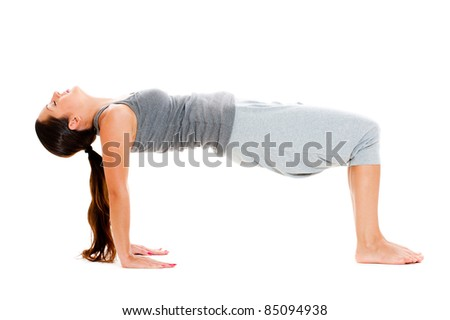 young woman doing yoga exercise over white background