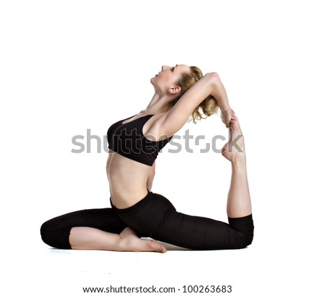 young woman doing yoga exercises isolated on white
