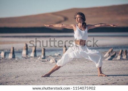 Young woman doing yoga in the morning