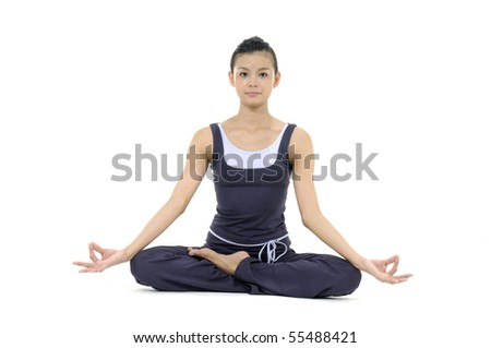 Young woman doing yoga moves or meditating