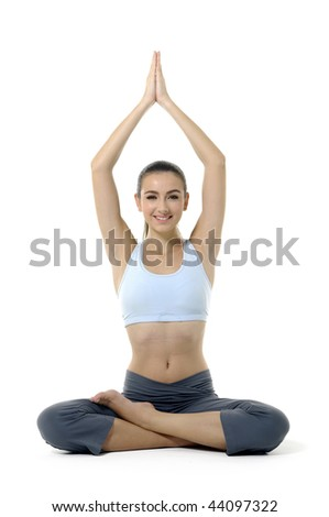 Young woman doing yoga moves or meditating on white stock photo