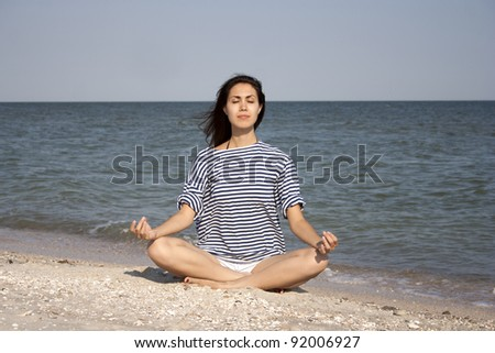 Young woman doing yoga outdoors - stock photo
