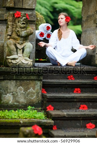 Young woman doing yoga outdoors in tranquil environment
