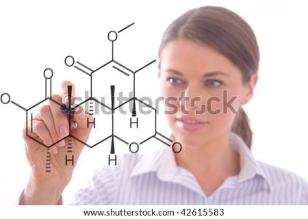 Young woman drawing a chemistry pattern with a black marker