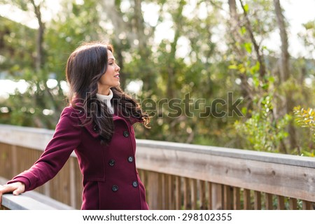 Young woman dressed for cold weather on nature walk
