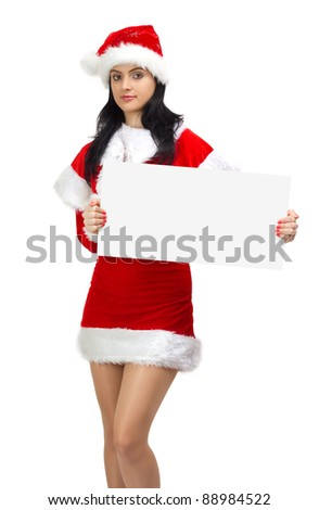Young woman dressed in Santa Claus holding a blank board - stock photo